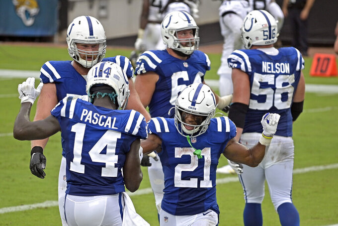 Indianapolis Colts running back Nyheim Hines (21) celebrates his touchdown against the Jacksonville Jaguars with teammate wide receiver Zach Pascal (14) during the first half of an NFL football game, Sunday, Sept. 13, 2020, in Jacksonville, Fla. (AP Photo/Phelan M. Ebenhack)