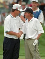 FILE - Kenny Perry, left, and Mark Brooks shake hands after Brooks won the PGA Championship golf tournament after a one-hole playoff at Valhalla Golf Club in Louisville, Ky., in this Sunday, Aug. 11, 1996, file photo. (AP Photo/Ed Reinke, File)