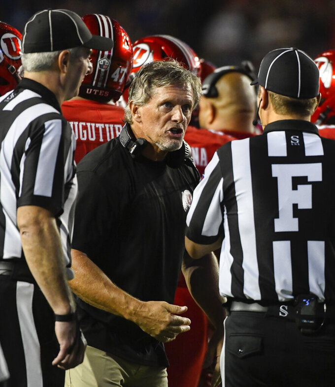 Utah head coach Kyle Whittingham speaks to the referees during the second half of an NCAA college football against Brigham Young game Saturday, Sept. 11, 2021, in Provo, Utah. (AP Photo/Alex Goodlett)