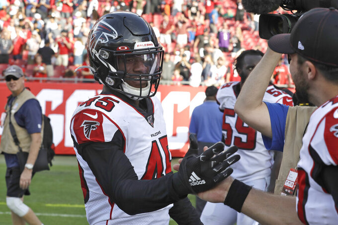 Atlanta Falcons linebacker Deion Jones (45) celebrates with teammates after scoring the game-winning touchdown against the Tampa Bay Buccaneers during overtime of an NFL football game Sunday, Dec. 29, 2019, in Tampa, Fla. (AP Photo/Chris O'Meara)