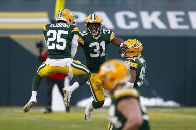 Green Bay Packers' Adrian Amos (31) celebrates with Will Redmond (25) after intercepting a pass intended for Tampa Bay Buccaneers' Mike Evans during the second half of the NFC championship NFL football game in Green Bay, Wis., Sunday, Jan. 24, 2021. (AP Photo/Matt Ludtke)