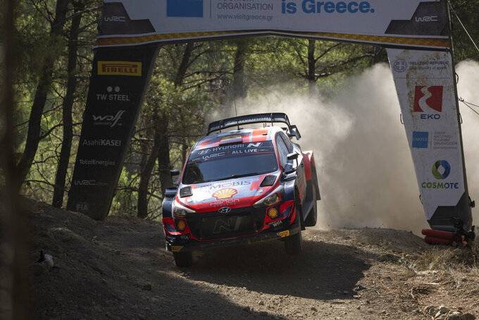 Jourdan Serderidis of Greece and his co driver Fred Miclotte of Belgium compete in the WRC Acropolis Rally at the stage of Aghii Theodori, west of Athens, on Friday, Sept. 10, 2021. The World Rally Championship returned to Greece after an eight-year absence. (AP Photo/Petros Giannakouris)