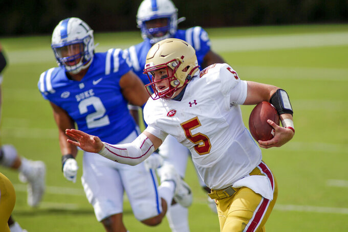 Boston College quarterback Phil Jurkovec (5) runs for a first down against Duke during the second half of an NCAA college football game, Saturday, Sept. 19, 2020, in Durham, N.C. (Nell Redmond/Pool Photo via AP)