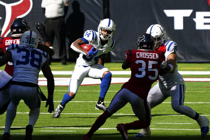 Indianapolis Colts cornerback Isaiah Rodgers (34) runs against the Houston Texans during the first half of an NFL football game Sunday, Dec. 6, 2020, in Houston. (AP Photo/David J. Phillip)