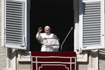 Pope Francis waves as he arrives for the Angelus noon prayer from the window of his studio overlooking St.Peter's Square, at the Vatican, Sunday, Nov. 22, 2020. (AP Photo/Alessandra Tarantino)