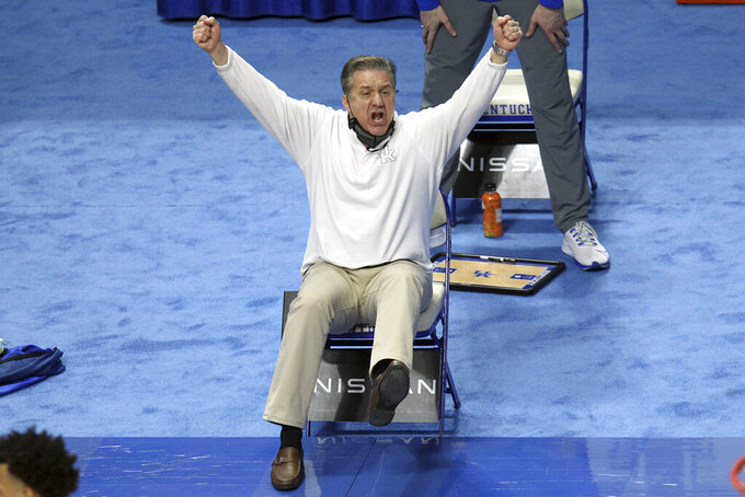 Kentucky head coach John Calipari reacts to a play during the first half of an NCAA college basketball game against Florida in Lexington, Ky., Saturday, Feb. 27, 2021. (AP Photo/James Crisp)