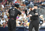 Boston Red Sox's Christian Vazquez (7), right, is congratulated by Brock Holt (12) after scoring during the fourth inning of a baseball game against the San Diego Padres, Saturday, Aug. 24, 2019, in San Diego. (AP Photo/Denis Poroy)