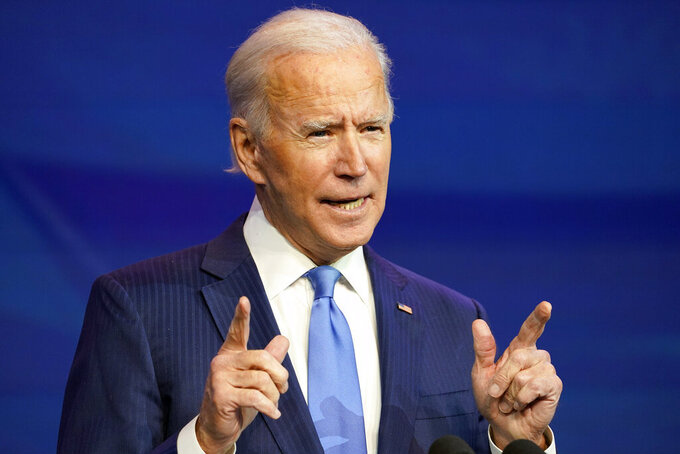 President-elect Joe Biden speaks during an event at The Queen theater in Wilmington, Del., Friday, Dec. 11, 2020. (AP Photo/Susan Walsh)