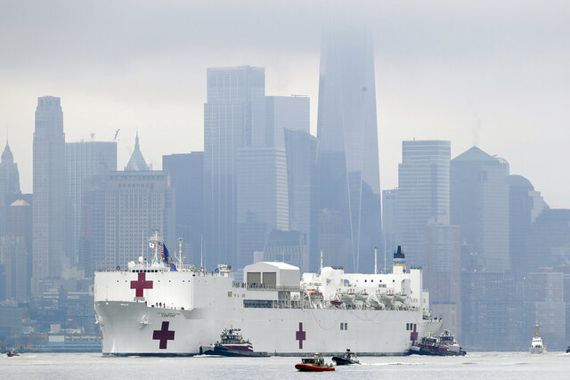 The Navy hospital ship USNS Comfort passes lower Manhattan on its way to docking in New York, Monday, March 30, 2020. The ship has 1,000 beds and 12 operating rooms that could be up and running within 24 hours of its arrival on Monday morning. It's expected to bolster a besieged health care system by treating non-coronavirus patients while hospitals treat people with COVID-19. AP Photo/Seth Wenig)