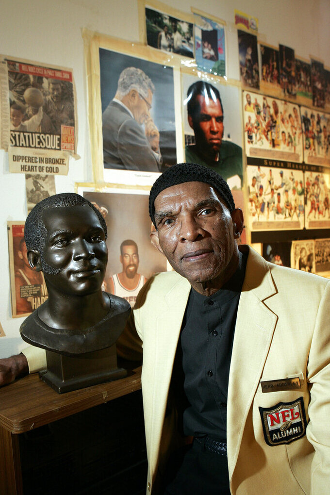 FILE - In this Oct. 2, 2008, file photo, former NFL player Herb Adderley poses next to a copy of his Hall of Fame bust in a room full of memorabilia from his playing days at his home in Mantua, N.J. Hall of Fame cornerback Herb Adderley has died. He was 81. His death was confirmed Friday, Oct. 30, 2020, on Twitter by nephew Nasir Adderley, a safety for the Los Angeles Chargers. Adderley played on six NFL title teams over a 12-year career with Green Bay and Dallas. (AP Photo/Mel Evans, File)