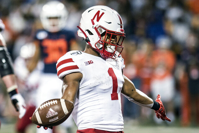 FILE - In this Sept. 21, 2019, file photo, Nebraska's Wan'Dale Robinson (1) scores in the second half of an NCAA college football game against Illinois in Champaign, Ill. Robinson has announced his plan to transfer. Robinson posted his decision on Twitter on Monday, Jan. 11, 2021, saying he wants to move closer to his family in Kentucky. (AP Photo/Holly Hart, File)