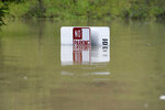 A No Parking sign is almost completely submerged in flood waters from the Russian River in Forestville, Calif., on Wednesday, Feb. 27, 2019. The still rising Russian River was engorged by days of rain from western U.S. storms. (AP Photo/Michael Short)