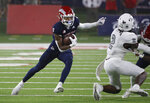 Fresno State Jalen Cropper looks to avoid UNLV defensive back Nohl Williams during the first half of an NCAA college football game in Fresno, Calif., Friday, Sept. 24, 2021. (AP Photo/Gary Kazanjian)