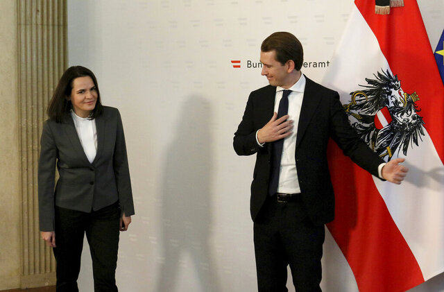 Austrian Chancellor Sebastian Kurz, right, welcomes Belarusian opposition leader Svetlana Tikhanovskaya before a meeting at the federal chancellery in Vienna, Austria, Thursday, Nov. 5, 2020. (AP Photo/Ronald Zak)