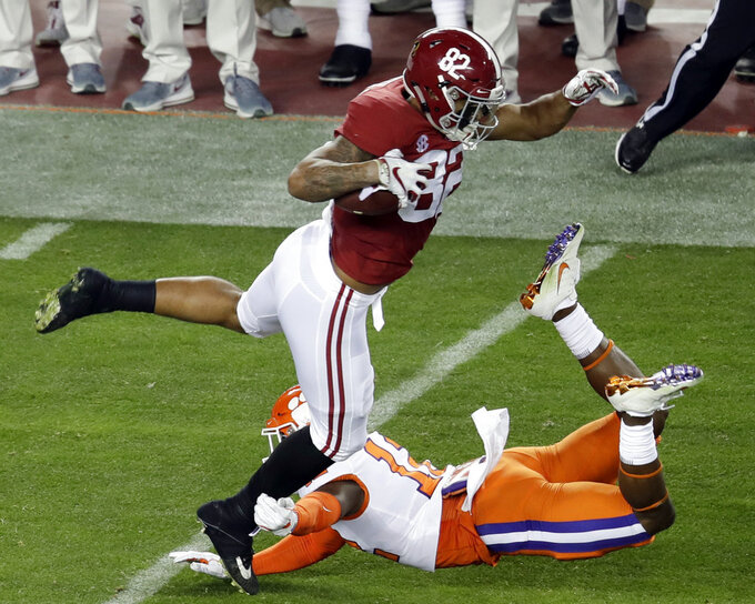 Clemson's K'Von Wallace tackles Alabama's Irv Smith Jr. during the first half the NCAA college football playoff championship game, Monday, Jan. 7, 2019, in Santa Clara, Calif. (AP Photo/Jeff Chiu)