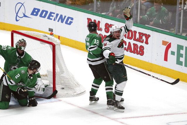 Minnesota Wild center Joel Eriksson Ek (14) celebrates after scoring the winning goal in the third period against the Dallas Stars during an NHL hockey game Friday, Feb. 7, 2020, in Dallas. (AP Photo/Richard W. Rodriguez)