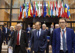 From left, European Commission President Jean-Claude Juncker, Irish Prime Minister Leo Varadkar, European Council President Donald Tusk and European Union chief Brexit negotiator Michel Barnier walk to a media conference at an EU summit in Brussels, Thursday, Oct. 17, 2019. Britain and the European Union reached a new tentative Brexit deal on Thursday, hoping to finally escape the acrimony, divisions and frustration of their three-year divorce battle. (AP Photo/Virginia Mayo)