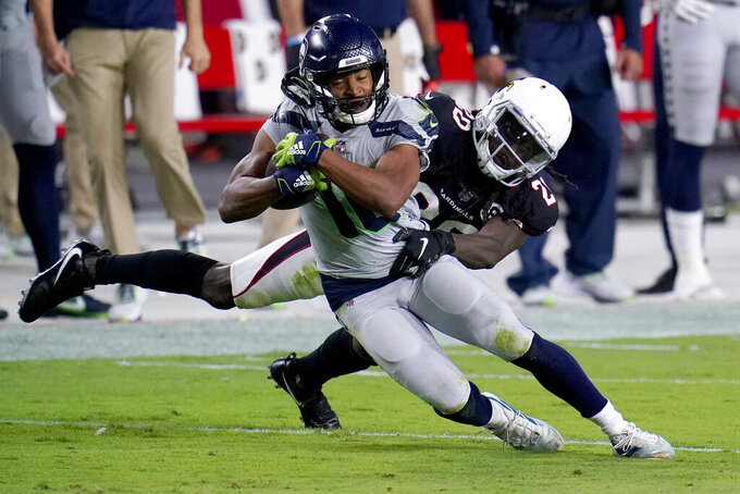 Seattle Seahawks wide receiver Tyler Lockett is tackled by Arizona Cardinals cornerback Dre Kirkpatrick, right during the first half of an NFL football game, Sunday, Oct. 25, 2020, in Glendale, Ariz. (AP Photo/Ross D. Franklin)
