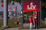 FILE - In this Feb. 4, 2021, file photo, Kansas City Chiefs fans take a selfie outside of Raymond James Stadium ahead of Super Bowl 55 in Tampa, Fla. The city is hosting Sunday's Super Bowl football game between the Tampa Bay Buccaneers and the Kansas City Chiefs. (AP Photo/Charlie Riedel, File)