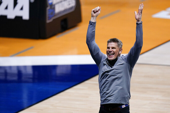 Loyola Chicago head coach Porter Moser celebrates after defeating Georgia Tech in a college basketball game in the first round of the NCAA tournament at Hinkle Fieldhouse, Indianapolis, Friday, March 19, 2021. (AP Photo/AJ Mast)