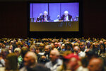 Shareholders in overflow rooms watch on big screens as Berkshire Hathaway Chairman and CEO Warren Buffett, left, and Vice Chairman Charlie Munger preside over the annual Berkshire Hathaway shareholders meeting in Omaha, Neb., Saturday, May 4, 2019. An estimated 40,000 people are thought to be in town for the event, where Buffett and Munger spend hours answering questions. (AP Photo/Nati Harnik)