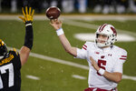 Wisconsin quarterback Graham Mertz (5) throws a pass during the second half of an NCAA college football game against Iowa, Saturday, Dec. 12, 2020, in Iowa City, Iowa. Iowa won 28-7. (AP Photo/Charlie Neibergall)