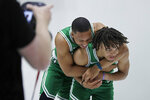 Boston Celtics' Grant Williams, left, grabs Carsen Edwards as they joke around during the NBA basketball team's media day, Monday, Sept. 30, 2019 in Canton, Mass. (AP Photo/Elise Amendola)