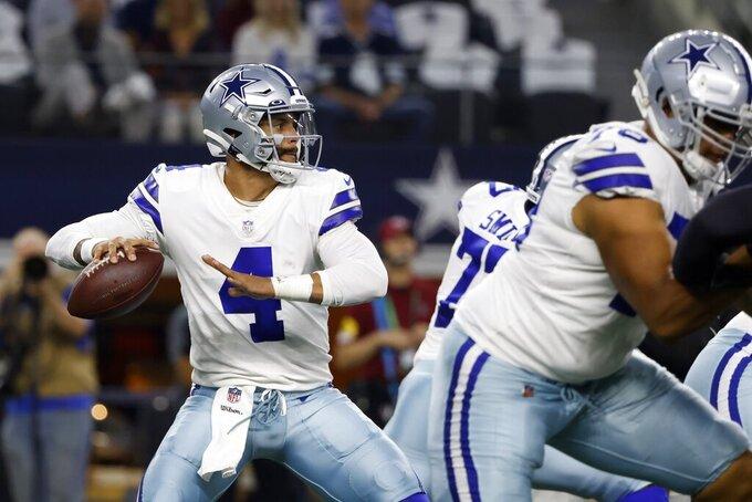 Dallas Cowboys quarterback Dak Prescott (4) prepares to throw a pass in the first half of an NFL football game against the Philadelphia Eagles in Arlington, Texas, Monday, Sept. 27, 2021. (AP Photo/Ron Jenkins)