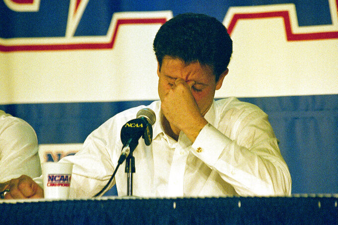 FILE - In this March 28, 1992, file photo, Kentucky head coach Rick Pitino reacts at a press conference after Duke beat Kentucky in overtime 104-103 in an East Regional Final NCAA college basketball game in Philadelphia.  (AP Photo/Charles Rex Arbogast, File)