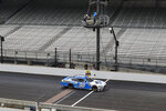NASCAR Xfinity Series driver Chase Briscoe takes the checked flag to win the NASCAR Xfinity Series auto race at Indianapolis Motor Speedway in Indianapolis, Saturday, July 4, 2020. (AP Photo/Darron Cummings)