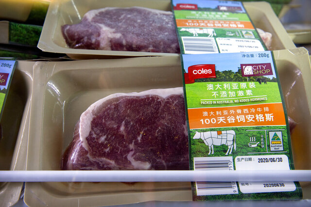 Frozen beef cuts from Australia are displayed at the Australian grocer Coles's booth at the China International Import Expo in Shanghai, Thursday, Nov. 5, 2020. China's government on Wednesday, Nov. 18, 2020, defended anti-coronavirus controls that have disrupted imports of beef, poultry and fish from the United States, New Zealand and other trading partners. (AP Photo/Mark Schiefelbein)
