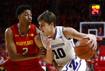 FILE - In this Jan. 29, 2019, file photo, Northwestern forward Miller Kopp, right, drives against Maryland guard Aaron Wiggins in the first half of an NCAA college basketball game in College Park, Md. Northwestern hopes to find its footing coming off back-to-back losing seasons since the school that hosted the NCAA's inaugural Final Four made the tournament for the first time. (AP Photo/Patrick Semansky, File)