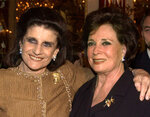 """FILE - In this May 22, 2000, file photo, Leah Rabin, left, widow of slain Israeli Prime Minister Yitzhak Rabin, poses with Jehan Sadat, widow of assassinated Egyptian President Anwar Sadat at a reception before being honored at the """"Broadway Salutes Seeds of Peace and the Peacemakers"""" gala at New York's Carnegie Hall. Jehan Sadat died in Cairo on Friday, July 9, 2021, at the age of 87, Egypt's President's office said. (AP Photo/Ron Frehm, File)"""
