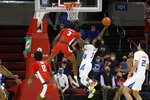 SMU guard Kendric Davis (3) takes a shot while Houston guard DeJon Jarreau (3) attempts a block during the first half of an NCAA college basketball game in Dallas, Sunday, Jan. 3, 2021. (AP Photo/Roger Steinman)