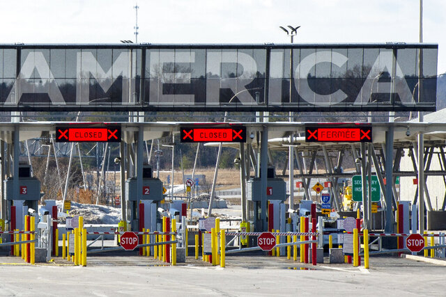 Several lanes at the United States border crossing in Lacolle, Quebec, is closed, Wednesday, March 18, 2020. The Canada-U.S. border will be closed to non-essential traffic in both directions