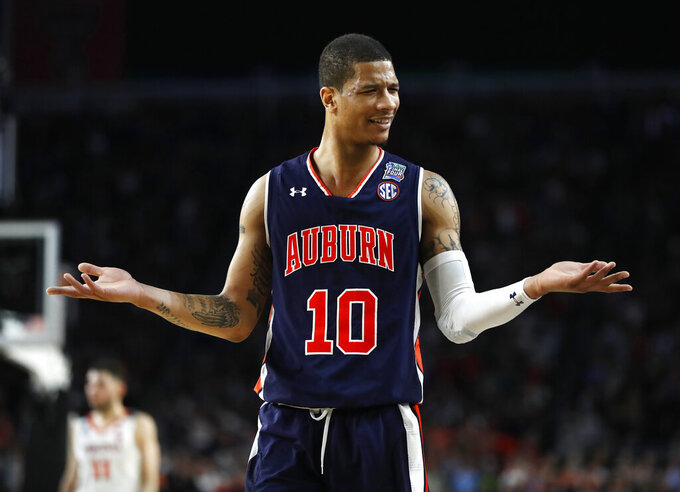 Auburn guard Samir Doughty reacts during the second half against Virginia in the semifinals of the Final Four NCAA college basketball tournament, Saturday, April 6, 2019, in Minneapolis. (AP Photo/Jeff Roberson)