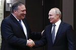 Russian President Vladimir Putin, right, and U.S. Secretary of State Mike Pompeo, shake hands prior to their talks in the Black Sea resort city of Sochi, southern Russia, Tuesday, May 14, 2019. Pompeo arrived in Russia for talks that are expected to focus on an array of issues including arms control and Iran. (AP Photo/Pavel Golovkin, Pool)