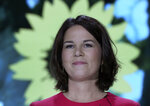 Germany's Green Party co-chairwoman Annalena Baerbock delivers a speech after beeing nominated as the party's chancellor candidate during a party convention of the Green Party in Berlin, Germany, Saturday, June 12, 2021. (AP Photo/Michael Sohn, pool)