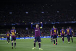 Barcelona's Lionel Messi, centre, celebrates after scoring his side's third goal during the Champions League round of 16, 2nd leg, soccer match between FC Barcelona and Olympique Lyon at the Camp Nou stadium in Barcelona, Spain, Wednesday, March 13, 2019. (AP Photo/Emilio Morenatti)
