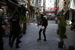 Turkish police move to disperse activists on a street in central Istanbul, after a Pride march event was banned by authorities, in Istanbul, Sunday, June 30, 2019. Activists gathered in Istanbul to promote rights for gay and transgender people Sunday before police dispersed the crowd at a pride event that Turkish authorities had banned for the fifth year. (AP Photo/Lefteris Pitarakis)
