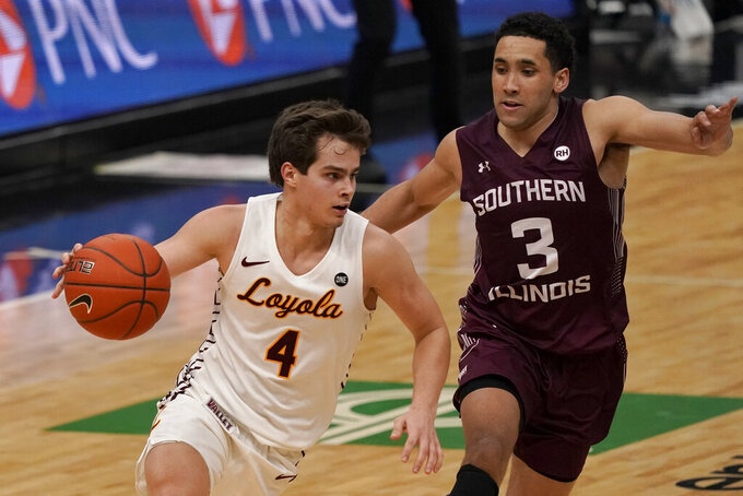 Loyola of Chicago's Braden Norris (4) heads to the basket past Southern Illinois' Dalton Banks (3) during the second half of an NCAA college basketball game in the quarterfinal round of the Missouri Valley Conference men's tournament Friday, March 5, 2021, in St. Louis. (AP Photo/Jeff Roberson)