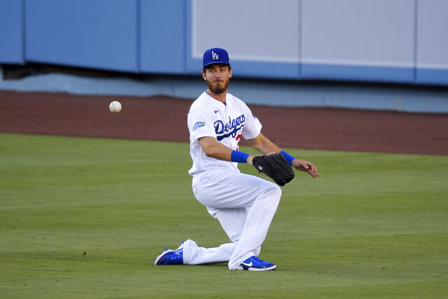 Los Angeles Dodgers' Cody Bellinger misjudges a ball hit for a double by Anthony Garcia during an intrasquad baseball game Wednesday, July 15, 2020, in Los Angeles. (AP Photo/Mark J. Terrill)