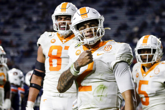 Tennessee quarterback Jarrett Guarantano (2) celebrates after scoring a touchdown against Auburn during the first half of an NCAA college football game Saturday, Nov. 21, 2020, in Auburn, Ala. (AP Photo/Butch Dill)
