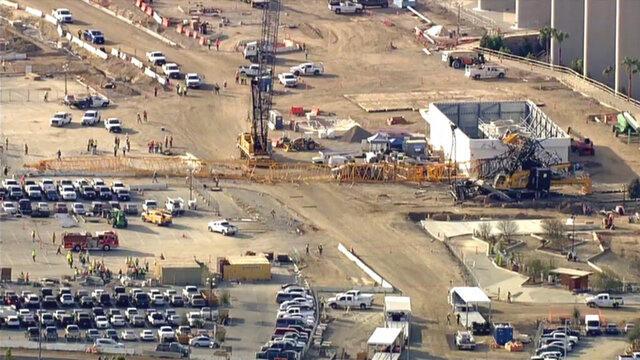 This image provided by KABC-TV shows a crane at a construction that collapsed outside SoFi Stadium, the new home of the Los Angeles Chargers and the Los Angeles Rams on Friday, Feb. 28, 2020 in  Inglewood, Calif. No injuries have been reported, fire department spokesman Franklin Lopez said. It's not clear what caused the crane to collapse in a parking lot outside the stadium.   (KABC-TV via AP)