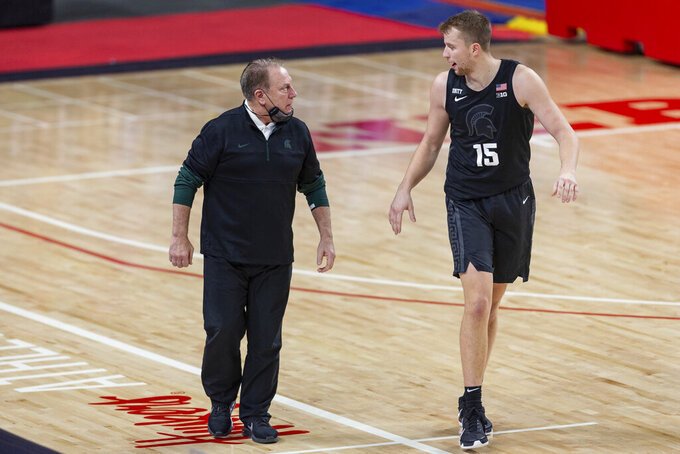 Michigan State head coach Tom Izzo talks to Michigan State forward Thomas Kithier (15) in the first half during an NCAA college basketball game against Nebraska on Saturday, Jan., 2, 2021, in Lincoln, Neb. (AP Photo/John Peterson)