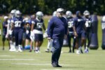 Dallas Cowboys head coach Mike McCarthy walks across the field as he watches workouts at the team's NFL football training facility in Frisco, Texas, Wednesday, Aug. 25, 2021. (AP Photo/Tony Gutierrez)
