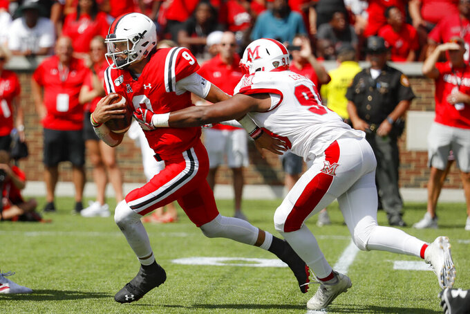 Cincinnati quarterback Desmond Ridder (9) is sacked by Miami of Ohio defensive lineman Dean Lemon, right, in the first half of an NCAA college football game, Saturday, Sept. 14, 2019, in Cincinnati. (AP Photo/John Minchillo)