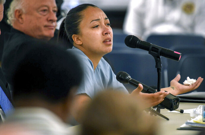 FILE - In this May 23, 2018 file photo, Cyntoia Brown appears in court during her clemency hearing at the Tennessee Prison for Women in Nashville, Tenn. Attorneys for the Tennessee woman serving a life sentence for killing a man when she was 16 are asking federal appellate judges to throw out her sentence, in a case that has attracted celebrity attention. Brown's attorneys will argue Thursday, June 14 before a 6th U.S. Circuit Court of Appeals panel. (Lacy Atkins/The Tennessean via AP, Pool)