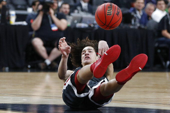 Washington State's CJ Elleby (2) passes the ball from the floor against Colorado during the second half of an NCAA college basketball game in the first round of the Pac-12 men's tournament Wednesday, March 11, 2020, in Las Vegas. (AP Photo/John Locher)