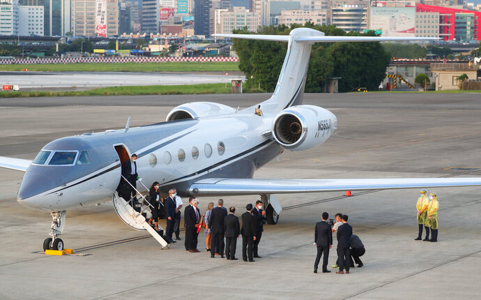 U.S. Under Secretary of State Keith Krach, center, gestures after disembarking from a plane upon arrival at the air force base airport in Taipei, Taiwan on Thursday, Sept. 17, 2020. Krach is in Taiwan on Thursday for the second visit by a high-level American official in two months, prompting a stern warning and threat of possible retaliation from China. (Pool Photo via AP Photo)